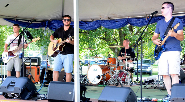 Christopher Aune | The Herald-Tribune<br /> Automation band members (from left) Ian Manlove, Derek Foster, Jason Manlove and Jon Scheidler provided solid entertainment for the fest. They are from Batesville, except Scheidler.