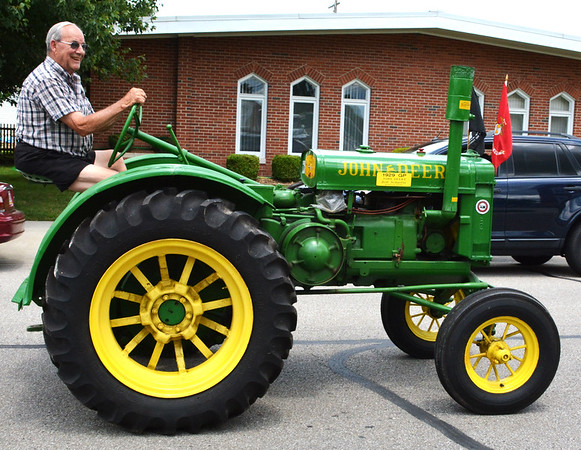 Debbie Blank | The Herald-Tribune<br /> Bob Schaefer drives a favorite tractor.