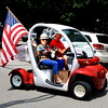 Debbie Blank | The Herald-Tribune<br /> Councilman Jim Fritsch, wife Diane and one of their dogs cruise down West Pearl Street during the Batesville Fire-Rescue Summerfest parade.