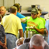 Christopher Aune | The Herald-Tribune<br /> Batesville firefighters served fried chicken and smoked pork chops to continuously long lines at the Liberty Park pavilion during Summerfest July 9.