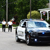 Debbie Blank | The Herald-Tribune<br /> After five police officers were killed in Dallas July 7, two days later Batesville police driving cars in the procession were met with spontaneous applause of support along the route. Accompanying this vehicle is the Batesville Veterans of Foreign Wars Post 3183 color guard.
