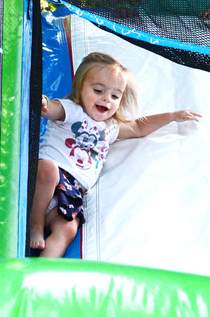 Christopher Aune | The Herald-Tribune<br /> This baby was pretty happy on the bouncy slide.