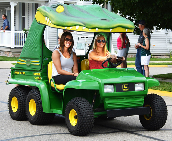 Debbie Blank | The Herald-Tribune<br /> The procession boasted all sorts of vehicles, even a Gator.
