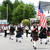Debbie Blank | The Herald-Tribune<br /> The 35th Indiana Pipe and Drum Corps, Lawrenceburg, brought unique entertainment to the procession.