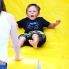 Christopher Aune | The Herald-Tribune<br /> The bounce houses and air slides were full of kids finding new ways to get a thrill.