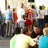 Christopher Aune | The Herald-Tribune<br /> Firefighters serve long lines waiting for fried chicken and smoked pork chops.