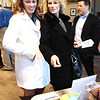 Debbie Blank | The Herald-Tribune<br /> Morgan (left) and mom Tori McVey, Morrow, Ohio, look over silent auction items at the first annual Hounds & Heroes Gala Feb. 25 at Third Place Event Center, Brookville. Proceeds benefitted Bear & Friends Animal Society, which saves dogs' and cats' lives in an effort to improve human lives by training the animals and, in the future, visiting persons at hospitals, schools, long-term care facilities and other sites.