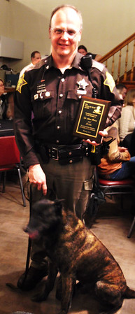 "Debbie Blank | The Herald-Tribune<br /> Franklin County Sheriff's Department Sgt. Adam Henson and K-9 Lito earned the Resolute Team Award  ""for your steadfast dedication and loyalty to your community."""