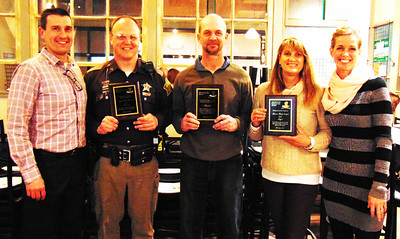 Debbie Blank | The Herald-Tribune Honorees are (from second from left) Sgt. Adam Henson, Resolute Team Award; Tim Broughton, representing dog Shadow, Noble Dog Award; and Lauren Hinderberger, Helping Hand & Paw Award. Their dogs Lito, Shadow and Angel, respectively, are not pictured. Celebrating with them are Bear and Friends Animal Society founders Drew Schneider (left) and Dr. Michelle Roberts-Schneider.