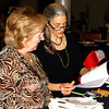 Debbie Blank | The Herald-Tribune<br /> Franklin County Humane Society members Eva Heyob (from left) and Teresa Miller check out the gala program. Later that evening they were thanked for providing expertise to Bear & Friends Animal Society.