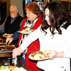 Debbie Blank | The Herald-Tribune<br /> Andrea Aragon (right), Sunbury, Ohio, leads the buffet line. Menu items included salad, chicken breast, green beans, potatoes, macaroni and cupcakes.