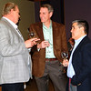 Debbie Blank | The Herald-Tribune<br /> Batesville Tool & Die retiree Jay Fledderman (from left) and current employees Terry Giesting and Jorge Lopez sample a few of the four wines offered during the tasting experience before the dinner.
