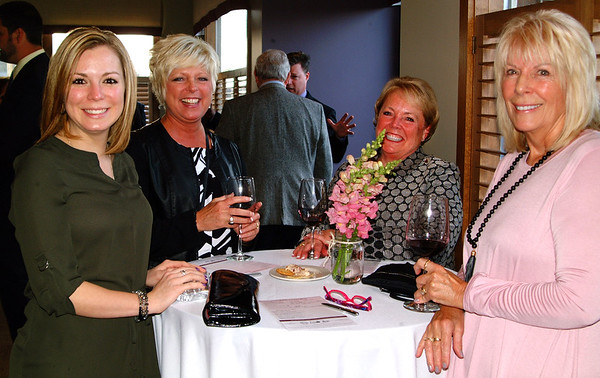Debbie Blank | The Herald-Tribune<br /> Anna Ibold (from left), Mary Huntington, Bev Broughton and Carolyn Bailiff enjoy appetizers and wine before the Science of Wine toasting dinner begins.