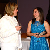 Debbie Blank | The Herald-Tribune<br /> Carla Austin (left) catches up with Elizabeth Miller during the Kids Discovery Factory's Science of Wine tasting event April 9.