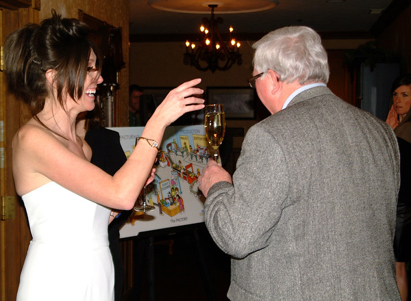 Debbie Blank | The Herald-Tribune<br /> Event volunteer Amy Watson was in charge of handing a glass of Italian sparkling prosecco to each guest. She gets a kick out of giving one to wine educator and guest speaker Jack Keegan.