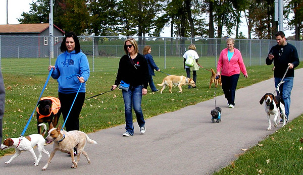 Debbie Blank | The Herald-Tribune<br /> Dogs of all sizes began the long paved route on the Liberty Trail, which takes between 45-60 minutes round trip from Liberty Park.