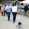 Debbie Blank | The Herald-Tribune<br /> At 3 p.m., Liberty Bark committee member Amanda Garlock, Batesville, and Daisy lead the short walk around the reservoir.