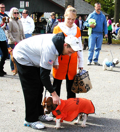Debbie Blank | The Herald-Tribune<br /> One dog and owner arrived in matching prison garb for the costume contest.