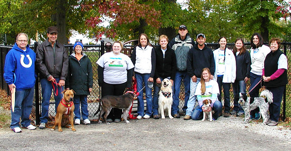 "Debbie Blank | The Herald-Tribune<br /> After the ribbon cutting to open the city's first permanent public dog park at Liberty Park Oct. 5, Mayor Rick Fledderman (far left) praised the volunteers. ""I'd like to congratulate all of you for making this a reality ... It's another great attribute for our community ... You've got a lot to be proud of."" Helpers include (from second from left) Eric and Mabel Sunderhaus, Shilo Hanna, Judy Behlmer, Jan and Bill Hortemiller, Nick Wewe, Laura Losacker (kneeling), Lisa Green, Lisa Flannery, Amanda Garlock and Susan Whistler."