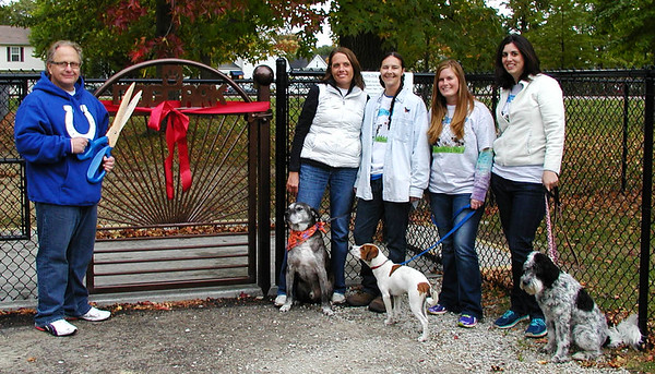 Debbie Blank | The Herald-Tribune<br /> Mayor Rick Fledderman (from left) prepares to cut the ribbon to officially open the city's first permanent public dog park at Liberty Park Sunday, Oct. 5. With him are Batesville Dog Park Committee members Judy Behlmer, Lisa Green, Laura Losacker and Amanda Garlock with dogs Archie, Chase (ready to adopt, call 932-DOGS) and Daisy.