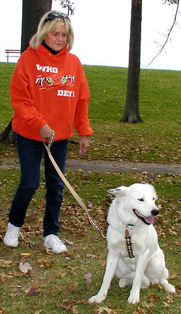 Debbie Blank | The Herald-Tribune<br /> Sharon McGuire, Sunman, prepares to walk Powder, her border collie mix.