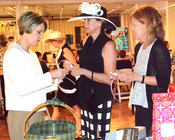 Debbie Blank | The Herald-Tribune<br /> Batesville residents (from left) Elaine Brouillette, Anne Raver and Rita Wilder get their raffle tickets ready at the April 18 Ripley County Community Foundation Women in Philanthropy Fundraising Luncheon at RomWeber Marketplace.