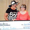 Debbie Blank   The Herald-Tribune<br /> Deanna Young (left), Napoleon, was surprised when her nonprofit, Bucket Buddies Mission, received a $1,500 grant.  Presenting the check is Lin Phaneuf. Attendees chose the organization from a handful of local projects.