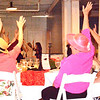 "Debbie Blank | The Herald-Tribune<br /> The speaker asked attendees to raise their hands higher and higher. ""I'm asking you to take my 40-day giving challenge. Start that challenge with a gift to the foundation – a gift that's going to stretch you. What can you give up"" to afford a contribution? ""Maybe it's your coffee, or dining out or a spring purse."""