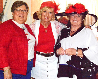 Debbie Blank | The Herald-Tribune Liz Stenger (from left), Terri Gardner and Bev Broughton were coordinated in red and white.