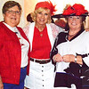 Debbie Blank | The Herald-Tribune<br /> Liz Stenger (from left), Terri Gardner and Bev Broughton were coordinated in red and white.