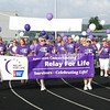 "Diane Raver | The Herald-Tribune<br /> CANCER SURVIVORS take the first lap around the track June 21 for the Ripley County Relay for Life. In the opening ceremony, event co-chair Jeni Schnebelt said, ""Everyone's reason for relay may be unique ... but together we can finish the fight."""