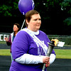 "Debbie Blank | The Herald-Tribune<br /> Brittany Lohrum, who was diagnosed with stage 4 Hodgkin's lymphoma, led the cancer survivors procession by carrying a torch. ""I went into remission in December,"" reported the Milan woman."
