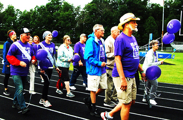 Debbie Blank | The Herald-Tribune<br /> Cancer survivors each have their own story, but could feel a bond as they circled the Batesville High School track together Saturday morning.