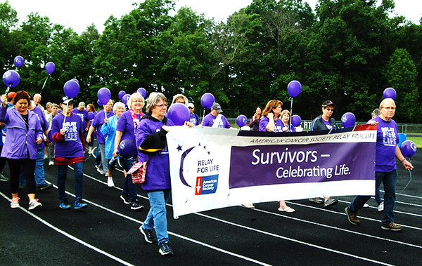 Debbie Blank | The Herald-Tribune<br /> After an opening ceremony under a large tent, the 24th Ripley County Relay for Life began with the survivors lap at the Batesville High School track Saturday, June 15. Please see more photos on page 5 and even more in a slide show on our website.