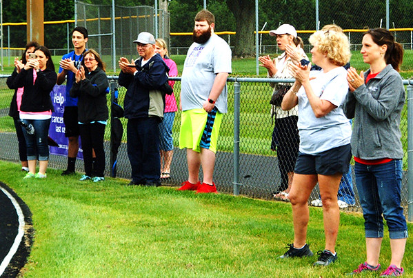 Debbie Blank | The Herald-Tribune<br /> As cancer survivors walked around the track, loved ones broke into spontaneous applause.