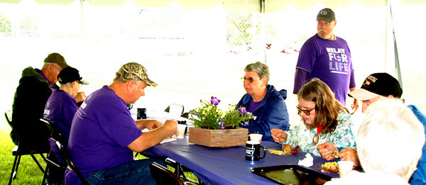 Diane Raver | The Herald-Tribune<br /> The buffet breakfast was courtesy of Izzy's of Hillcrest. Centerpieces with purple flowers featured the Relay for Life's signature color.