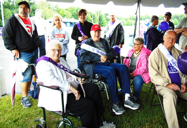 Diane Raver | The Herald-Tribune<br /> Friends (seated from left) Jean Struewing, Jim and Char Dreyer and Ham Struewing stay dry under the big tent.