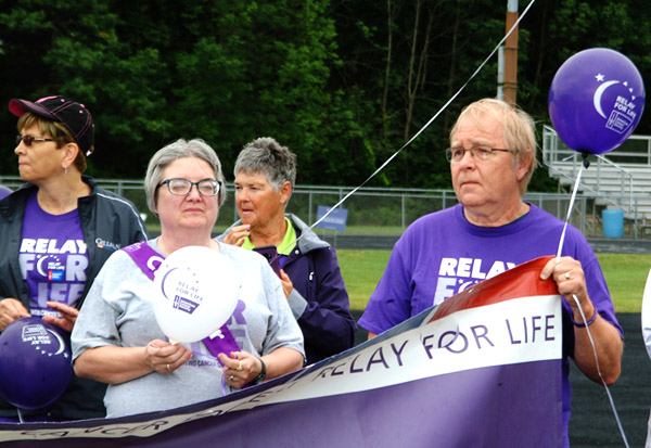 Debbie Blank | The Herald-Tribune<br /> Cancer survivor Dennis Dietz (front right) holds the banner next to wife and caregiver Sandy Dietz. Behind them are Theresa Eckstein (right) and Rhonda Belter.