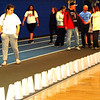 Debbie Blank | The Herald-Tribune<br /> Due to turbulent storms off and on all day, the luminary service took place in the new Batesville High School activity center and ended the relay at 9:15 p.m. instead of the original 1 a.m. June 16 closing. Attendees viewed luminarias that featured names of cancer survivors and victims who have died.