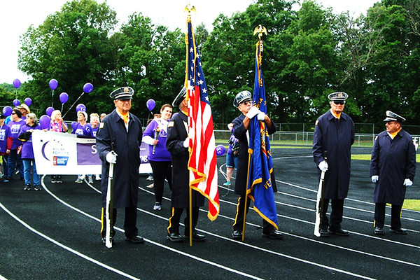 Debbie Blank | The Herald-Tribune<br /> A Batesville Veterans of Foreign Wars Post 3183 honor guard led survivors on the relay's first lap.