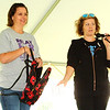 Diane Raver | The Herald-Tribune<br /> Organizers Alicia Hodapp (left) and Ashley Riechers plus the crowd of mostly females had a lot of fun at the purse auction, another way money was raised to research cancer treatments and cures.