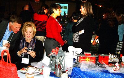 Debbie Blank   The Herald-Tribune Roger and Janet Kirschner (from left) check a phone message while Nancy Mullen and Mary K. Cambron get caught up at a table with a train theme.