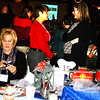 Debbie Blank | The Herald-Tribune<br /> Roger and Janet Kirschner (from left) check a phone message while Nancy Mullen and Mary K. Cambron get caught up at a table with a train theme.