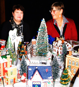 """Debbie Blank   The Herald-Tribune Marty Junker (left) and Vonni Williamson sit at one of the 30 tables. This one was decorated by Children's Health Care with the theme """"Our Community"""" and depicted buildings including the Gibson Theatre and 5 Oaks. """"We know when we come here we're going to see some incredible table decorations by for-profits and nonprofits,"""" said Dan Mattingly."""