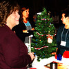 Debbie Blank | The Herald-Tribune<br /> Kim Inscho (from left), Theresa Fullenkamp and Dr. Kimberly Kick admire table decorations at We Help. We Heal. We Hope, Safe Passage's benefit Dec. 1 at The Barn at Walhill Farm.
