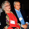 "Debbie Blank | The Herald-Tribune<br /> Speaking of Joan Hillenbrand (left), Batesville, master of ceremonies Dan Mattingly said, ""This event was her idea. Seven years ago she brought this idea to Safe Passage."" The announcement was met with applause. With her is husband John."