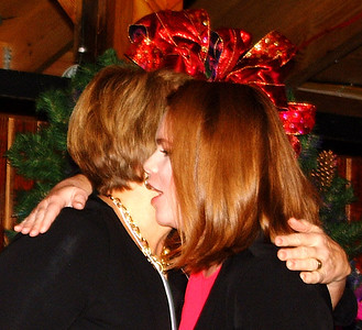 Debbie Blank | The Herald-Tribune Tory Flynn (right) and Jane Yorn embrace after Flynn spoke about her experiences as a rape victim.