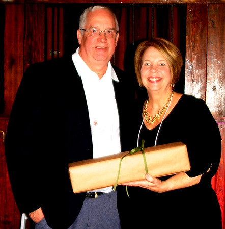 "Debbie Blank | The Herald-Tribune<br /> Mick Wilz (left), Brookville, was honored as a Safe Passage Champion by executive director Jane Yorn. Wilz served on the board for six years, three as president. She wrote, ""During his term, the organization experienced unprecedented growth in services and community engagement. Mick led with vision and elbow grease and, most notably, by example."""