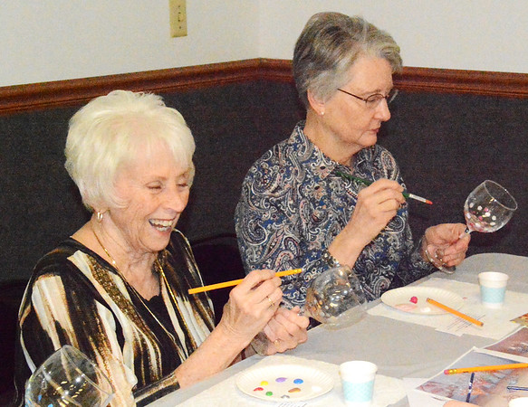 Debbie Blank   The Herald-Tribune After deciding which colors they would like, Batesville residents Jane Roberson (left) and Joan Stephens paint souvenir wineglasses.