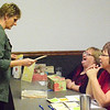 Debbie Blank | The Herald-Tribune<br /> Phi Beta Psi Xi Chapter Treasurer Rhonda Belter (from right) and Reporter Lisa Haessig welcome Mary Wallpe, Batesville, to the second Soups n' Sips fundraiser for area cancer patients. Attendees voted on their favorite soups: Pearl Street Pub Potato Soup, first place; Big Four Cafe Italian Stew, second place; and Walhill Farm Forest Blend Mushroom Soup, third place.